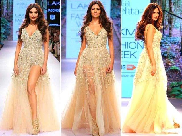 In-slinky-cut-outs-sheer-wraps-and-layers-of-gypsy-jewellery-Esha-Gupta-steamed-up-the-LFW-runway-on-Day-2-in-a-creation-by-designer-Arpita-Mehta-AFP