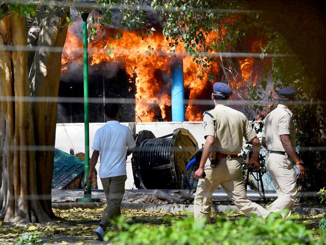 Security-personnel-rush-at-the-spot-after-a-major-fire-broke-out-in-the-AC-plant-of-Parliament-complex-in-New-Delhi-PTI-Photo
