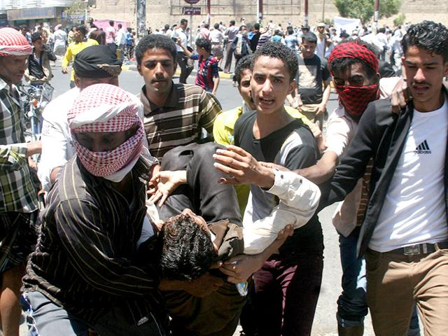 Anti-Houthi-protesters-carry-an-injured-fellow-protester-during-calshes-with-Houthi-fighters-in-Yemen-s-southwestern-city-of-Taiz-Reuters-Photo
