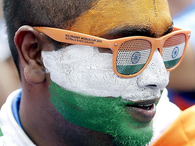 An-Indian-cricket-fan-has-his-face-painted-with-colors-of-the-Indian-flag-during-the-World-Cup-Pool-B-match-between-India-and-Pakistan-in-Adelaide-Australia-Sunday-Feb-15-2015-AP-Photo0