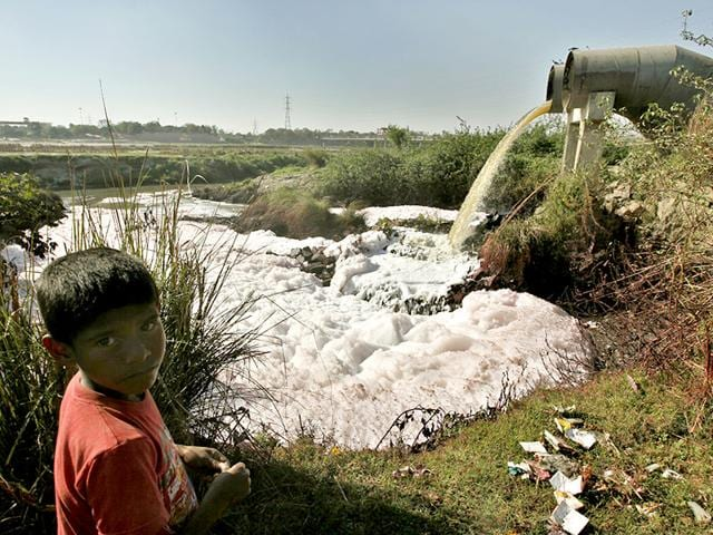 A-child-showing-polluted-water-flowing-into-the-Yamuna-river-Raj-K-Raj-HT-Photo