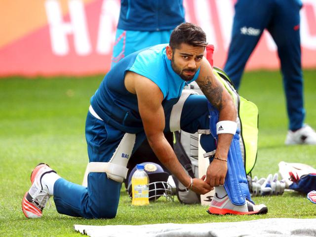 Virat-Kohli-puts-on-his-protective-pads-during-a-training-session--AFP-Photo-Michael-Bradley