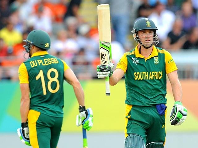 AB-de-Villiers-raises-his-bat-after-completing-his-fifty-50-runs-while-batting-against-New-Zealand-during-their-Cricket-World-Cup-semifinal-in-Auckland-AP-Photo-Ross-Setford