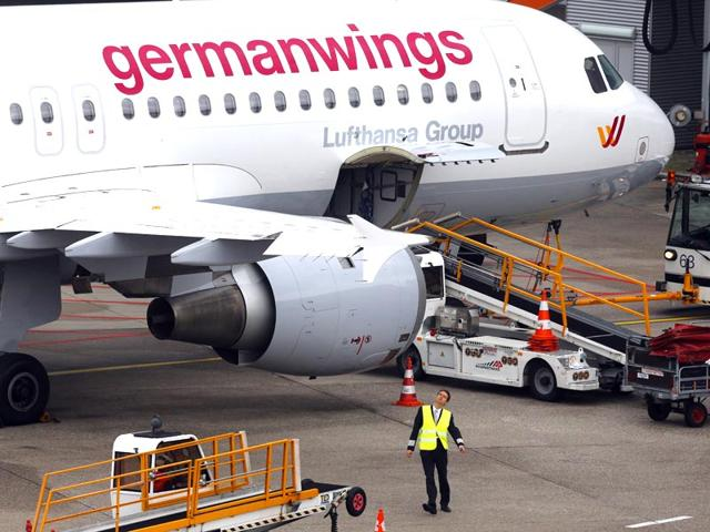 Germanwings-employees-cry-as-they-place-flowers-and-lit-candles-outside-the-company-headquarters-in-Cologne-Bonn-airport--Reuters