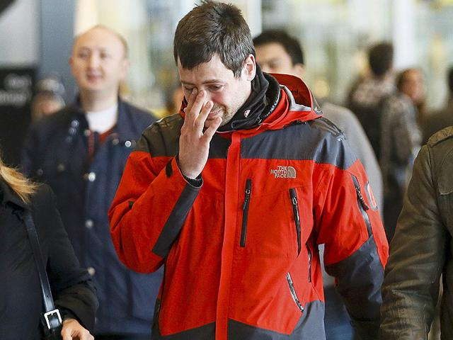A family member of a passenger killed in Germanwings plane crash reacts as he arrives at Barcelona