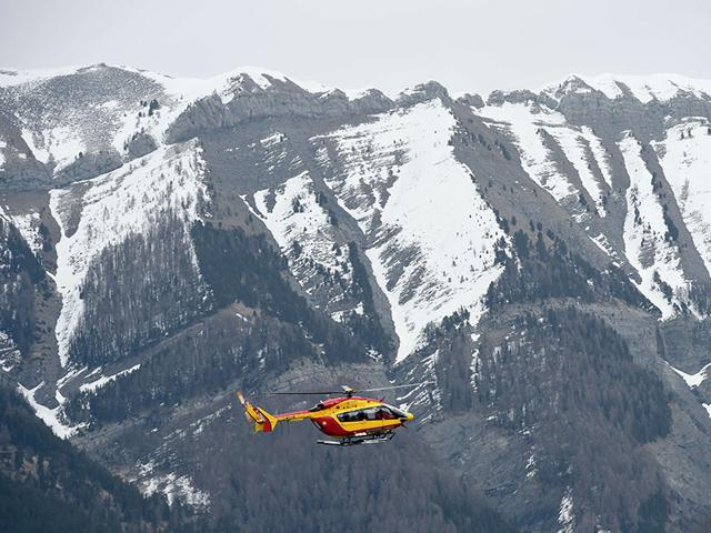 A helicopter of the French civil security services flies near Seyne, south-eastern France. (AFP Photo)