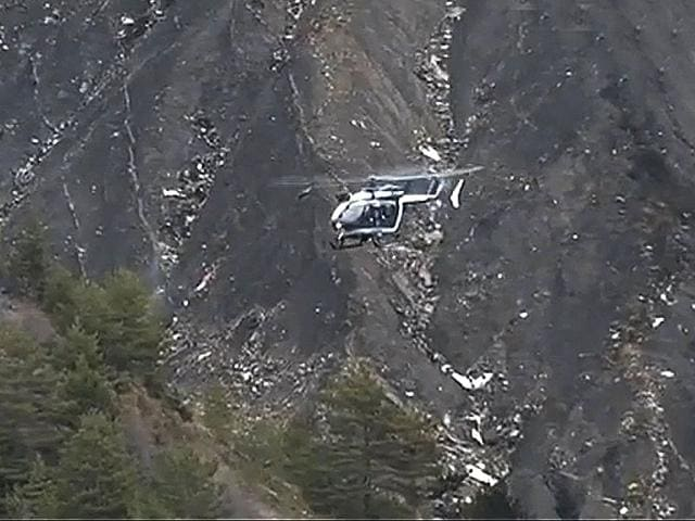 A rescue helicopter from the French Gendarmerie hovers in front of the crash site of an Airbus A320, near Seyne-les-Alpes, in this still image taken from TV. (Reuters Photo)