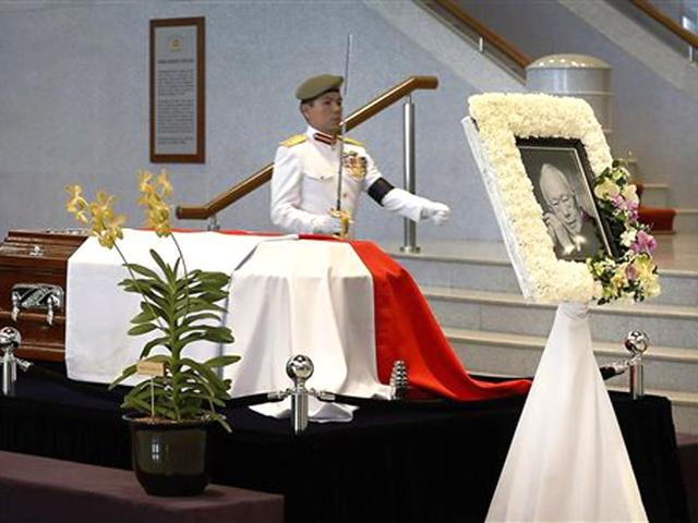 A-vigil-guard-marches-to-his-position-beside-the-coffin-of-the-late-Lee-Kuan-Yew-at-the-Parliament-House-where-he-will-lie-in-state-for-four-days-AP-photo
