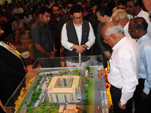 Union-minister-of-state-for-home-affairs-Kiren-Rijiju-looks-at-the-model-of-the-proposed-central-forensic-science-laboratory-building-after-laying-its-foundation-stone-in-Bhopal-on-Tuesday-Mujeeb-Faruqui-HT-photo