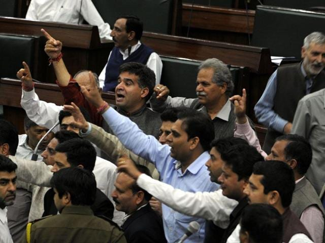 BJP-MLAs-protesting-against-National-conference-MLA-Javed-Rana-remarks-against-the-speaker-in-House-during-the-budget-session-in-Jammu-Nitin-Kanotra-HT