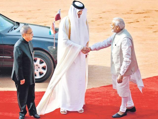 President-Pranab-Mukherjee-and-Prime-Minister-Narendra-Modi-welcome-Qatar-s-Emir-Sheikh-Tamim-bin-Hamad-Al-Thani-as-he-arrives-at-Rashtrapati-Bhavan-on-Wednesday-Ajay-Aggarwal-HT-Photo