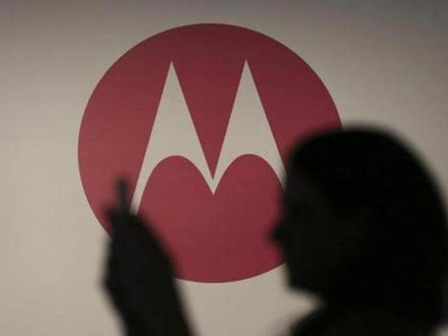A-woman-takes-a-picture-in-front-of-a-Motorola-logo-before-the-worldwide-presentation-of-the-Moto-G-mobile-phone-in-Sao-Paulo-Photo-Reuters