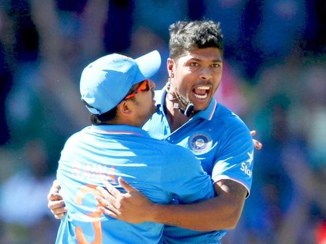 Australia-vs-India-LIVE-Umesh-Yadav-celebrates-with-Suresh-Raina-during-their-Cricket-World-Cup-semi-final-match-in-Sydney-March-26-2015-REUTERS