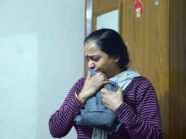 In-this-photograph-taken-on-February-22-2015-Anita-Rajput-gestures-as-she-tells-relatives-stories-of-her-18-year-old-son-Mukul-Rajput-after-his-death-in-a-road-accident-in-New-Delhi-AFP-Photo