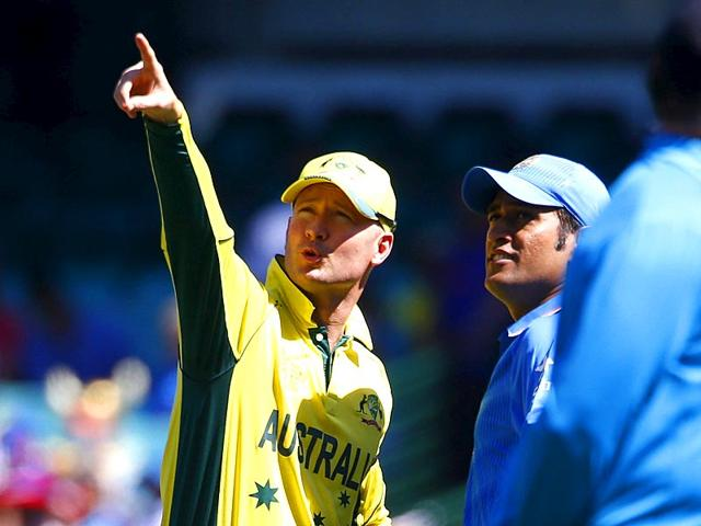 Michael-Clarke-and-India-s-captain-MS-Dhoni-look-at-a-feature-of-the-Sydney-Cricket-Ground-before-their-World-Cup-semi-final-match-in-Sydney-March-26-2015-REUTERS