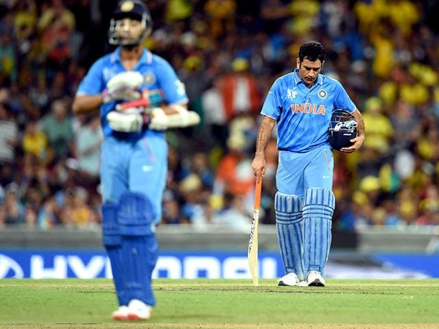 India-s-captain-Mahendra-Singh-Dhoni-R-reacts-after-fellow-batsman-Ajinkya-Rahane-L-was-dismissed-by-Australia-during-their-2015-Cricket-World-Cup-semifinal-match-in-Sydney--AFP-Photo