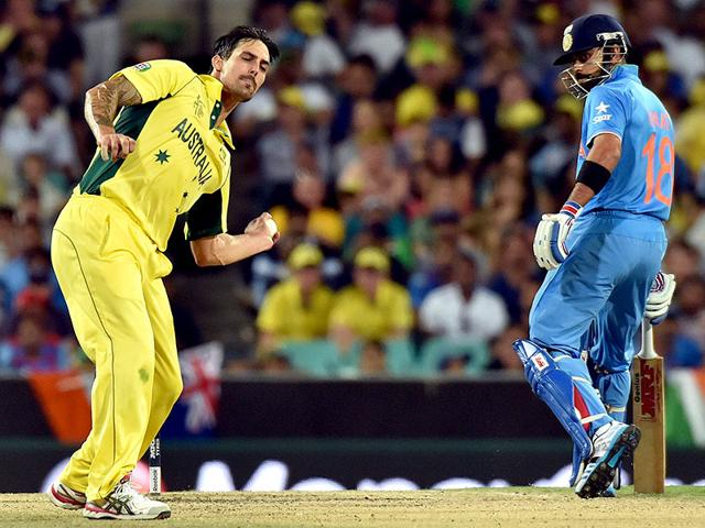 Australia-s-paceman-Mitchell-Johnson-L-fields-on-his-own-bowling-as-India-s-batsman-Virat-Kohli-R-looks-on-during-the-World-Cup-semifinal-at-Sydney-Cricket-Ground--AFP-Photo