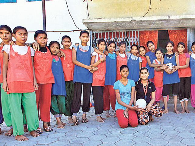 Alka-Singh-and-Radha-Gaud-sitting-with-their-touchdown-handball-team-at-Kasturba-Gandhi-Balika-Vidyalaya-in-Sarangpur-HT-photo