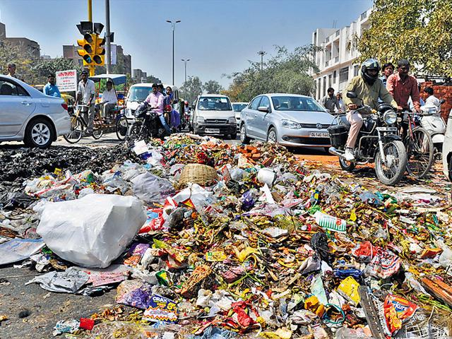 NDMC-sanitation-workers-littered-garbage-on-the-roads-to-mark-their-protest-against-non-payment-of-salaries-HT-Photo-Mohd-Zakir