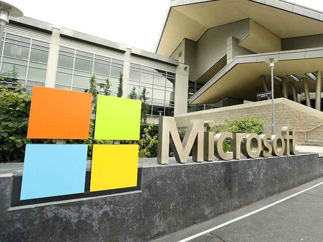 Microsoft Corp,Microsoft Corp reports quarterly net loss,Nokia phone business