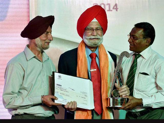 Hockey-veterans-Harbinder-Singh-and-Ashok-Kumar-with-Balbir-Singh-Senior-c-being-honoured-with-Lifetime-Achievement-Award--at-the-Hockey-India-Awards-in-New-Delhi-PTI-Photo-