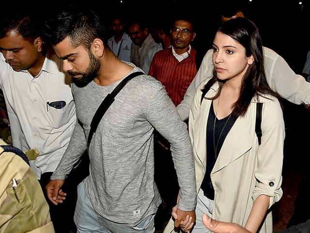 Virat Kohli and Anushka Sharma hold hands as they arrive at the Chhatrapati Shivaji International Airport in Mumbai, with the Indian cricket team, on March 27, 2015. (Photo: IANS)