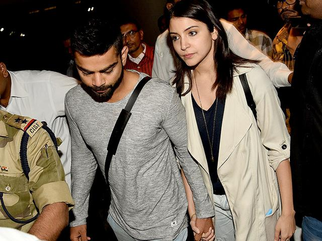 Indian-cricketer-Virat-Kohli-and-actor-Anushka-Sharma-arrive-at-the-Chhatrapati-Shivaji-International-Airport-in-Mumbai-from-Australia-with-the-Indian-cricket-team-on-March-27-2015--Their-body-language-is-being-perceived-as-Virat-s-solidarity-with-girlfriend-Anushka-who-is-widely-being-blamed-for-his-poor-performance-in-the-World-Cup--Photo-IANS