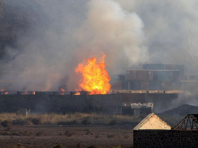 Flames-and-smoke-billow-from-the-site-of-an-explosion-that-hit-an-arms-depot-in-Yemen-s-second-city-of-Aden-on-March-28-2015-A-series-of-explosions-rocked-an-arms-depot-in-Yemen-s-second-city-killing-at-least-nine-people-as-looters-swarmed-the-facility-witnesses-and-an-official-said-AFP-Photo