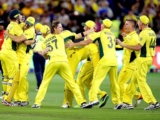 Australia-s-captain-Michael-Clarke-holds-the-Cricket-World-Cup-trophy-as-he-celebrates-with-teammates-and-support-staff-after-they-defeated-New-Zealand-in-the-final-match-at-the-Melbourne-Cricket-Ground-MCG-Reuters