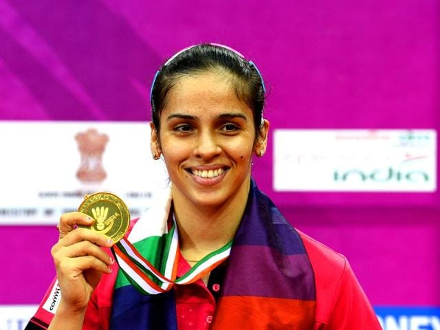 Saina-Nehwal-of-India-displays-her-gold-medal-after-winning-her-women-s-singles-final-match-against-Ratchanok-Intanon-of-Thailand-at-the-Yonex-Sunrise-India-Open-2015-at-the-Siri-Fort-Sports-complex-in-New-Delhi-AFP-Photo-Sajjad-Hussain