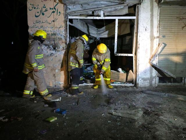 Afghan-firefighters-spray-water-at-the-site-of-a-suicide-attack-targeting-parliamentarian-Gul-Pacha-Mujedi-in-Kabul-Afghanistan-AP-Photo