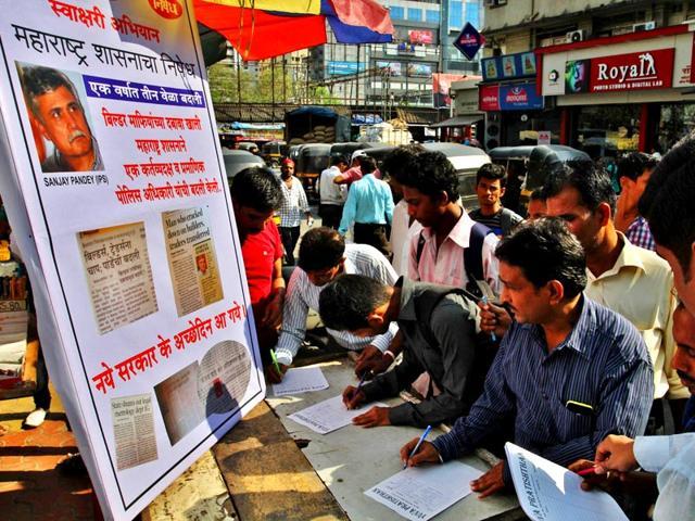 A-signature-campaign-was-started-against-the-transfer-order-of-Sanjay-Pandey-controller-of-legal-metrology-organisation-LMO-at-Ghatkopar-station-Praful-Gangurde-HT-photo
