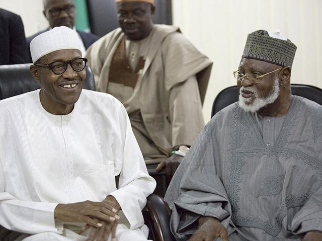 Nigerian-former-Gen-Muhammadu-Buhari-left-and-former-Nigeria-President-Abdulsalami-Abubakar-right-watch-the-announcement-of-presidential-election-results-in-Abuja-Nigeria-AP-Photo