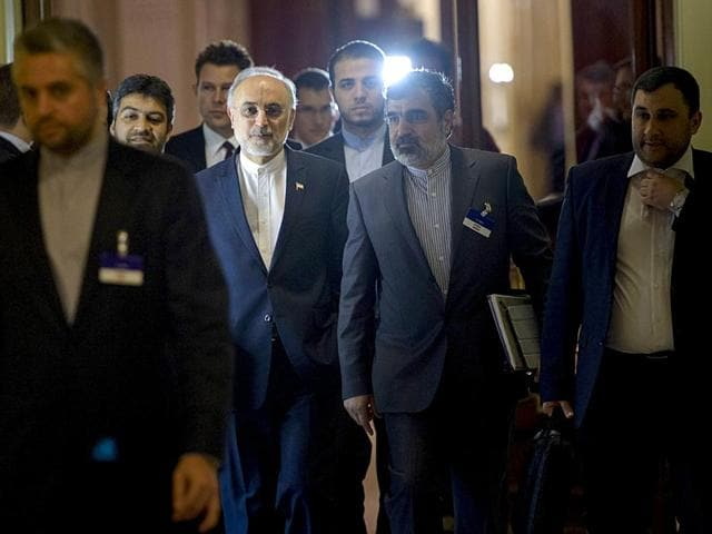 Head-of-Iranian-Atomic-Energy-Organization-Ali-Akbar-Salehi-walks-with-others-during-a-break-in-a-meeting-with-world-powers-representatives-seeking-to-pin-down-a-nuclear-deal-with-Iran-on-March-31-2015-in-Lausanne-AFP-Photo