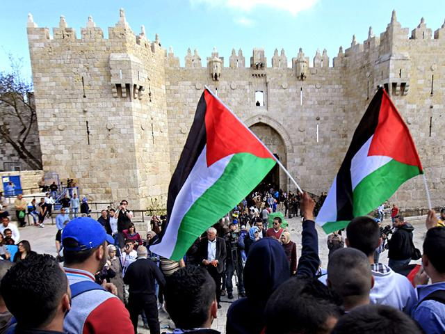 Palestinians-carry-national-flags-during-a-protest-in-front-of-the-Damascus-Gate-in-Jerusalem-s-Old-City-The-Palestinians-formally-join-the-International-Criminal-Court-as-part-of-a-broader-effort-to-put-international-pressure-on-Israel-and-exact-a-higher-price-for-its-occupation-of-lands-sought-for-a-Palestinian-state-AP-Photo
