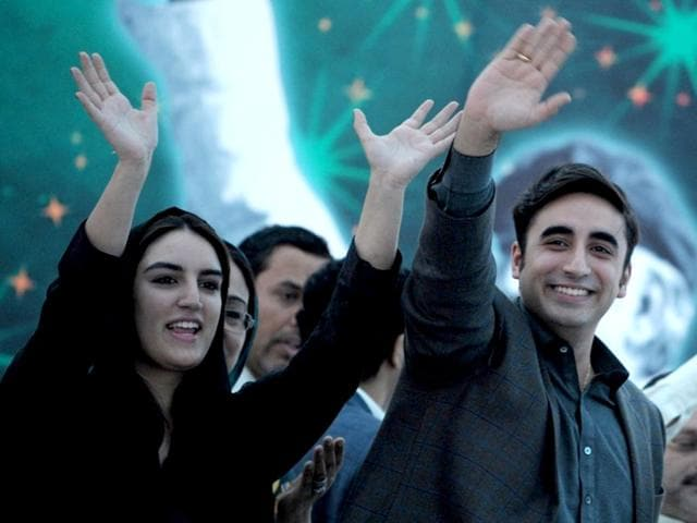 Chairman-of-Pakistan-Peoples-Party-Bilawal-Bhutto-Zardari-and-his-sister-Bakhtawar-wave-to-supporters-at-a-rally-in-Karachi-on-November-30-2013-AFP-PHOTO