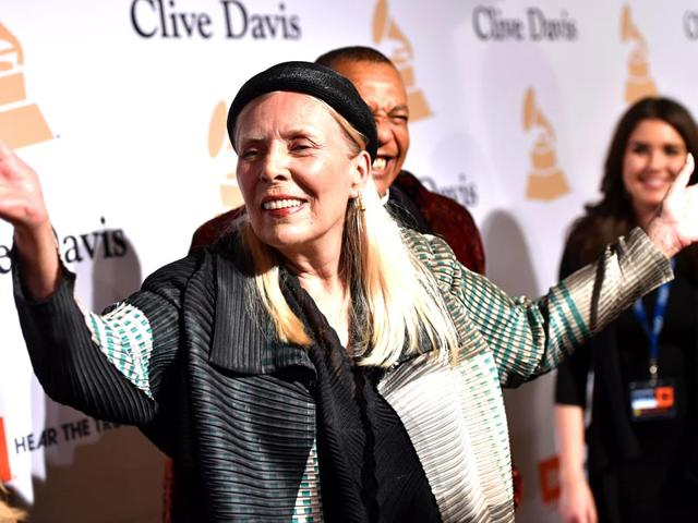 In-this-Feb-7-2015-file-photo-Joni-Mitchell-arrives-at-the-2015-Clive-Davis-Pre-Grammy-Gala-in-Los-Angeles-USA-Mitchell-was-hospitalized-in-Los-Angeles-on-Tuesday-March-31-2015-according-to-the-Twitter-account-and-website-of-the-folk-singer-and-Rock-and-Roll-Hall-of-Famer-but-details-on-her-condition-have-not-been-released-AP