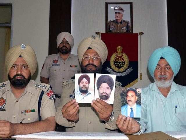 Harjinder-Singh-C-DCP-HS-Brar-R-ADCP-Special-and-Harjit-Singh-Dhaliwal-L-ACP-north-release-the-pictures-of-the-accused-in-the-suicide-case-of-Amritsar-based-cable-operator-Jaswinder-Singh-Jassi-HT-Photo