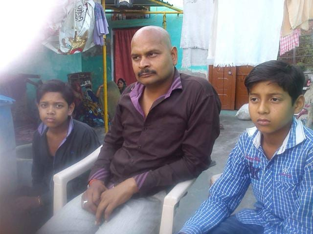 Sunita-s-husband-Brijendra-Singh-Tomar-with-their-sons-13-year-old-Dhruv-and-10-year-old-Kuldeep-HT-Photo