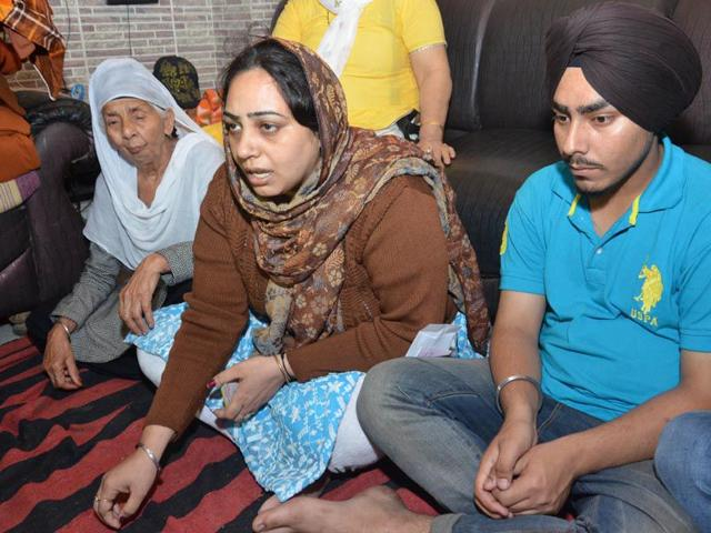 Balbir-Kaur-wife-of-cable-operator-Jaswinder-Singh-during-a-candle-march-to-protest-against-failure-of-police-and-state-government-in-Amritsar-on-Tuesday-Sameer-Sehgal-HT