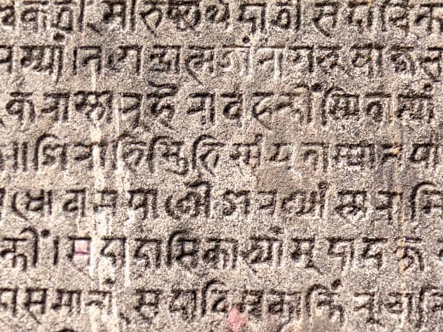 Ancient-Indian-text-etched-in-stone-File-photo-shutterstock-com