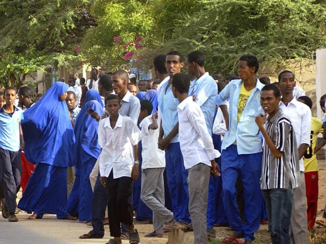 Students-gather-and-watch-from-a-distance-outside-the-Garissa-University-College-which-witnessed-a-fierce-attack-by-armed-gunmen-on-Thursday-AP-Photo