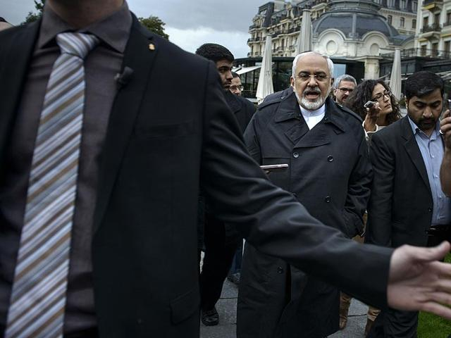 Iranian-Foreign-Minister-Javad-Zarif-talks-to-members-of-the-media-while-walking-through-a-courtyard-at-the-Beau-Rivage-Palace-Hotel-during-an-extended-round-of-talks-in-Lausanne-Switzerland-Photo-AFP
