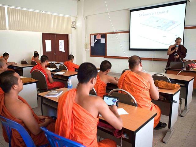 This-picture-taken-on-February-26-2015-shows-Buddhist-monks-in-a-classroom-at-the-Mahachulalongkornrajavidyalaya-Buddhist-university-in-Ayutthaya-province-north-of-Bangkok-AFP-PHOTO