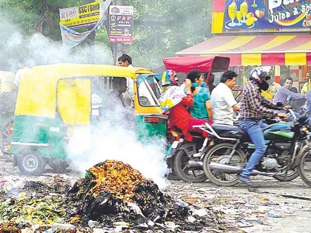 A-heap-of-garbage-left-burning-on-the-road-by-sweepers-on-an-east-Delhi-road-Sanjiv-Verma-HT-Photo