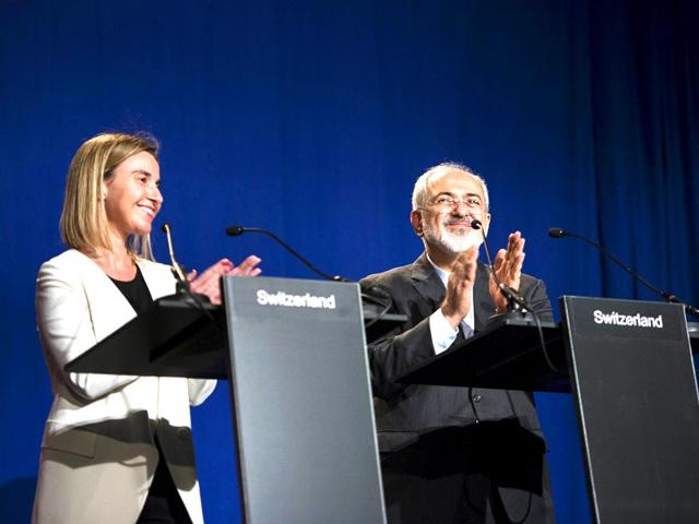 European-Union-High-Representative-for-Foreign-Affairs-and-Security-Policy-Federica-Mogherini-L-and-Iranian-Foreign-Minister-Javad-Zarifat-clap-after-making-statements-following-nuclear-talks-at-the-Swiss-Federal-Institute-of-Technology-in-Lausanne-Reuters-Photo