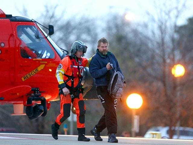 Louis-Jordan-right-walks-from-the-Coast-Guard-helicopter-to-the-Sentara-Norfolk-General-Hospital-in-Norfolk-after-being-found-off-the-North-Carolina-coast-AP-Photo