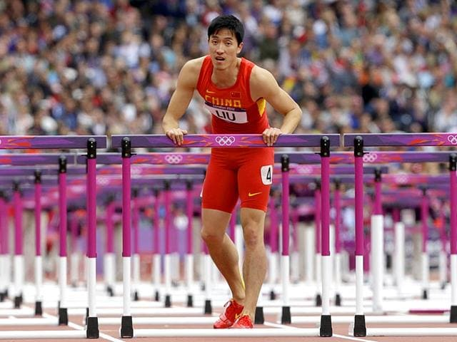 Despite-appearing-to-hit-a-rich-vein-of-form-leading-up-to-London-2012-Liu-clattered-into-the-first-hurdle-in-his-opening-heat-and-after-being-helped-up-he-hopped-the-length-of-the-track-before-symbolically-kissing-the-last-barrier-and-exiting-the-Olympic-arena-AP-Photo