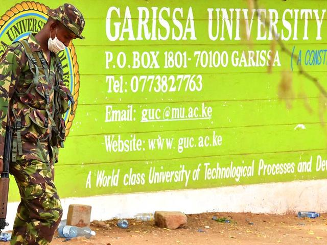A-Kenya-Defence-forces-soldier-walks-past-the-front-entrance-of-Moi-University-Garissa-a-day-after-the-massacre-of-147-students-by-Somalia-s-Al-Qaeda-linked-Shebab-fighters-AFP-Photo