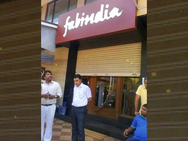 BJP-MLAs-Michael-Lobo-and-Pramod-Sawant-stand-outside-a-showroom-where-HRD-minister-Smriti-Irani-found-a-camera-installed-in-the-changing-room-at-Candolim-in-Goa-PTI-Photo